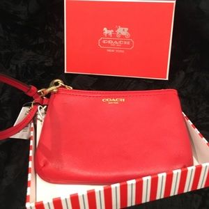 New w/tags and box red leather wristlet